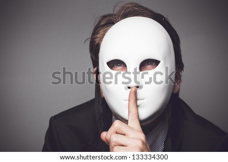 Man with a white mask - stock photo