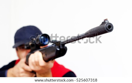 Man with air rifle