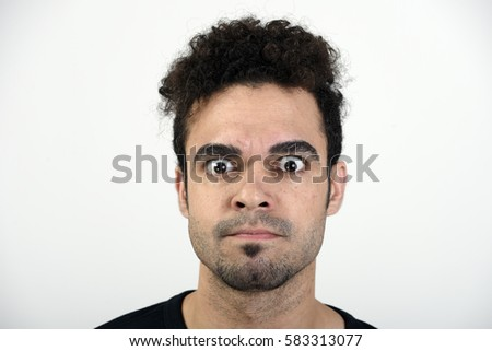 Man with an angry expression and eyes wide open