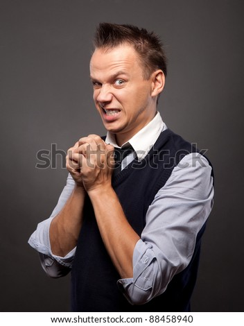 man with an angry threatening or disgusted look on his face - stock photo