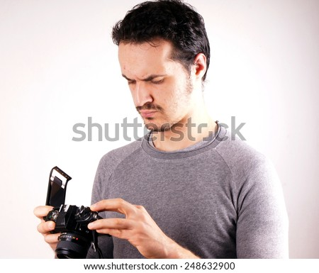 Man with analogic camera  - stock photo