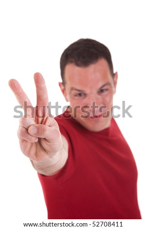 man with arm raised in victory sign, isolated on white background. Studio shot - stock photo