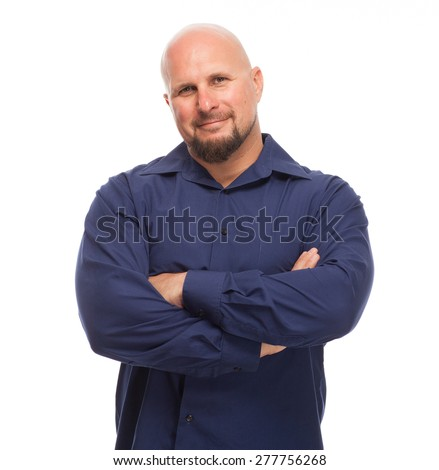 Man with arms crossed and a smile on his face. Portrait of bald, handsome young man isolated on white background.  - stock photo