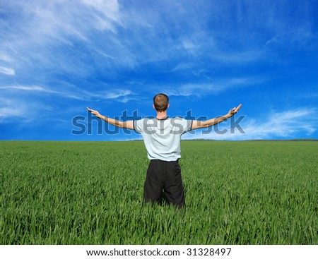 man with arms outstretched to the sky