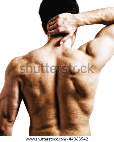 Man with back or nape pain - stock photo