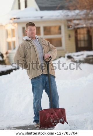 Man with back pain from shoveling snow - stock photo