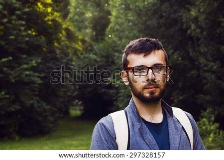 Man with backpack in the forest