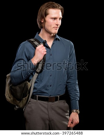 Man with backpack.  Studio shot over black. - stock photo