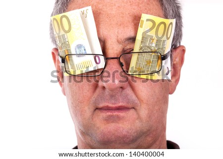Man with banknotes behind the glasses - stock photo