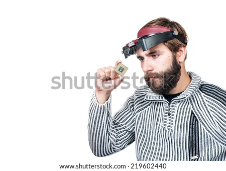 man with beard considering a chip it is isolated on a white background - stock photo