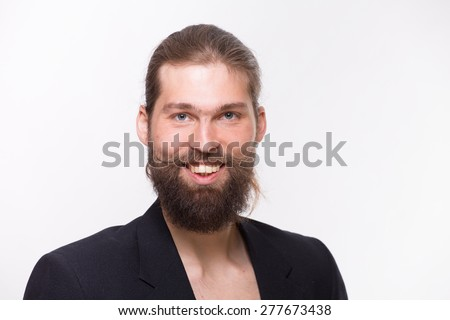 Man with beard in black suit smile sincerely on white background - stock photo