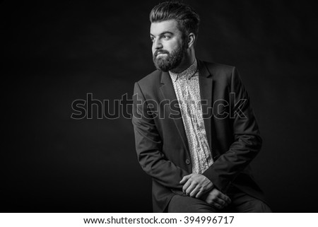 man with beard in suit,black and white, homogeneous