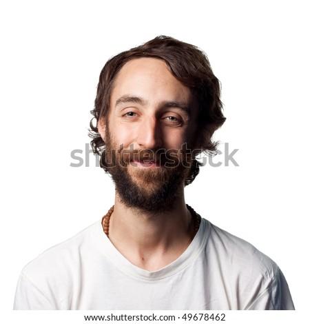 Man with beard smiles - stock photo