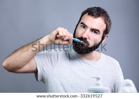Man with Beard Washing His Teeth with a Toothbrush