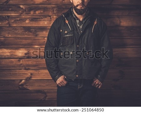 Man with beard  wearing waxed canvas jacket