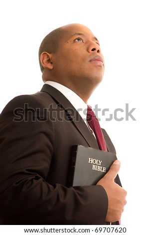 Man with Bible Looking Up Holding the Bible - stock photo