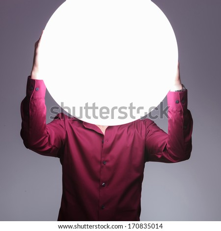 man with big ball of light as a head in the hear no evil pose - stock photo