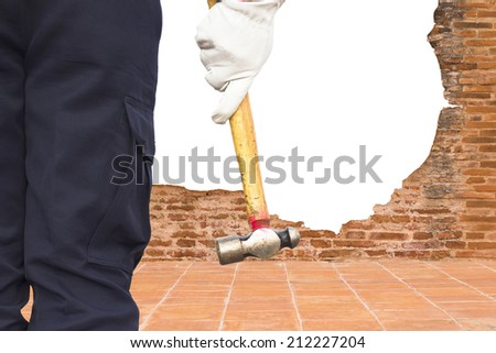 man with big hammer against wall
