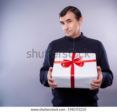 man with big present for christmas - stock photo