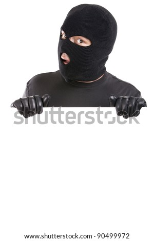 man with black mask and gloves holding a large white sign - stock photo