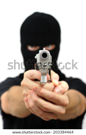 Man with black mask out of focus pointing a gun, Isolated on white - stock photo