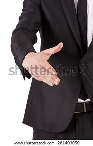 man with black suit shaking hands - stock photo