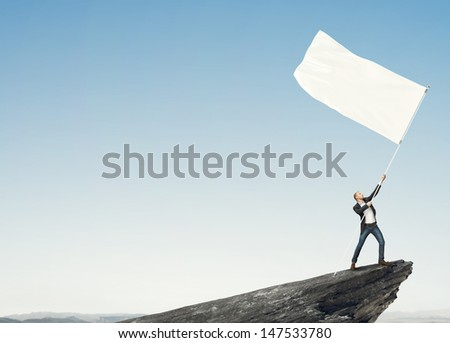 Man with blank flag - stock photo