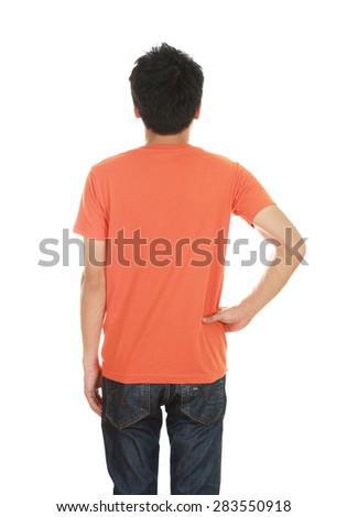 man with blank orange t-shirt (back side) isolated on white background - stock photo