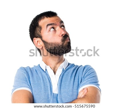 Man with blue shirt having doubts
