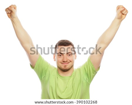 man with both hands raised in the air.  - stock photo