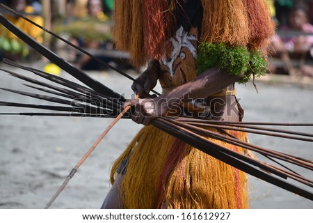 Man with bow and arrow traditional tribal weapon