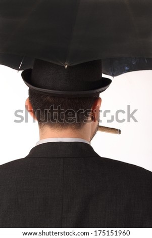 man with bowler hat, cigar and  umbrella