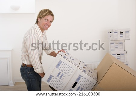 Man with boxes, portrait - stock photo