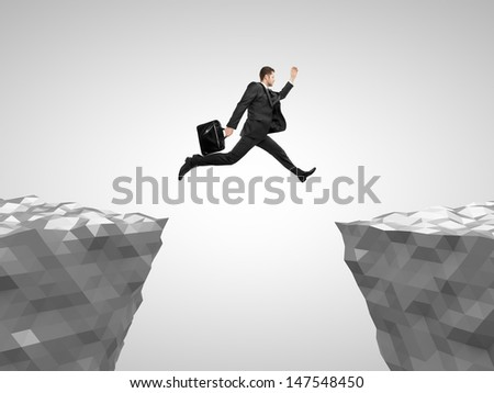 man with briefcase  jumping from mountain to mountain - stock photo