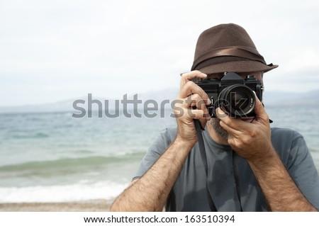 Man with camera - stock photo