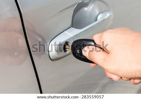 man with car key