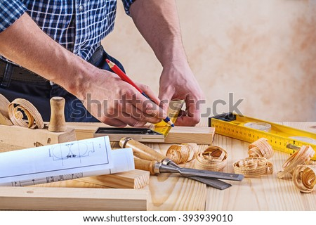 Man with carpenters tools construction concept. - stock photo