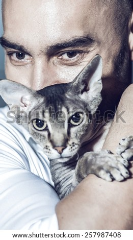 man with cat - stock photo
