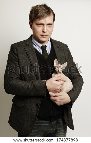 Man with cat, fashion portrait - stock photo
