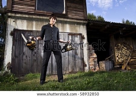 man with chainsaws - stock photo