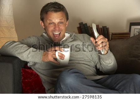 Man With Coffee Watching Television Excitedly