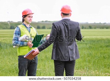 man with cottage plan construction