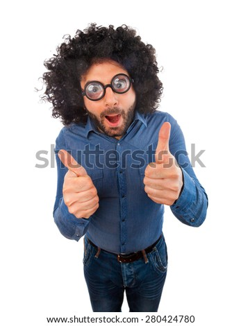 Man with crazy expression and thumb up on white background. - stock photo