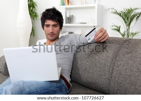 Man with credit card and computer