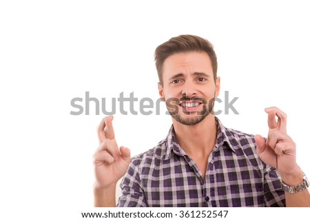 Man with crossed fingers, isolated over a white background
