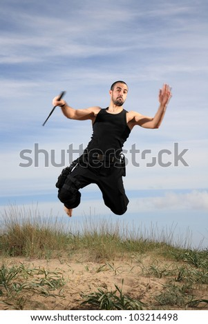 man with crowbar in the air,motion blur - stock photo