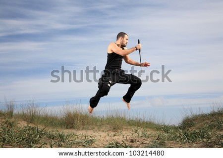 man with crowbar jumping - stock photo