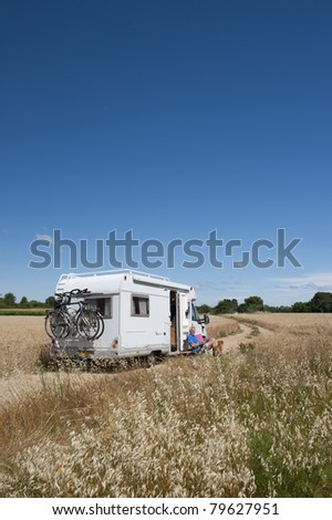 Man with dog on a trip with mobile home