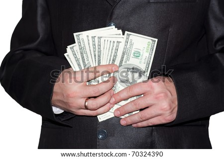 man with dollars in pocket. male getting money out of suit to pay