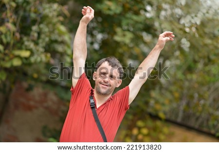 Man with Downs Syndrome - stock photo